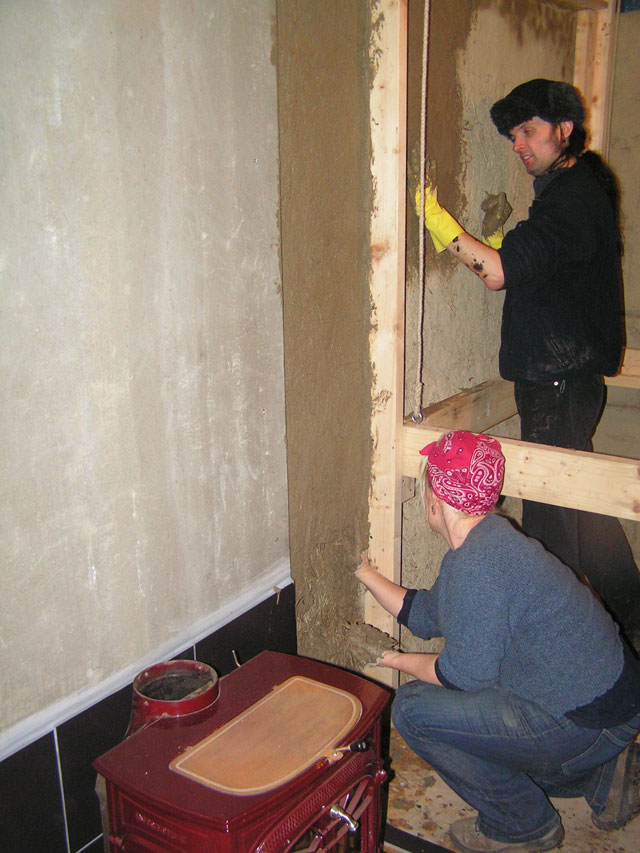 smearing clay on walls