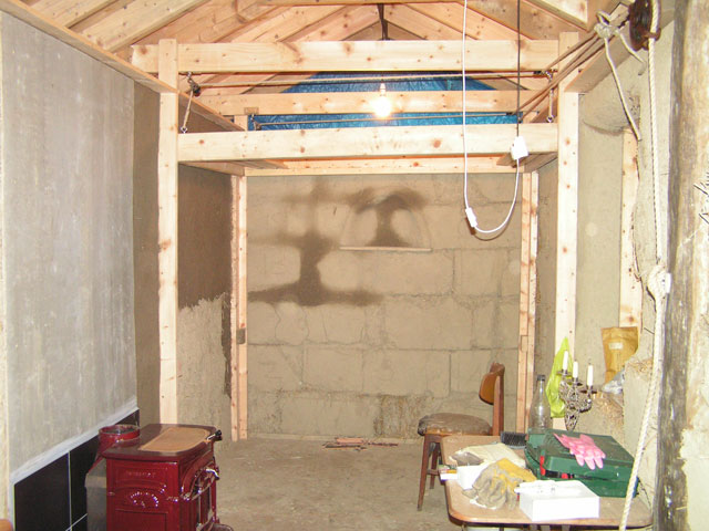 The bed, hoisted up to the ceiling.