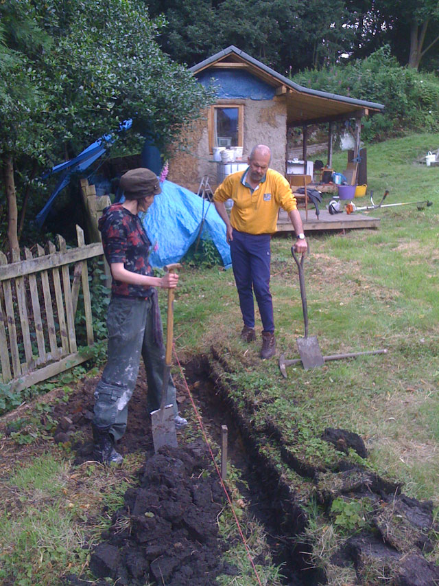 Hazel and Bob digging a trench
