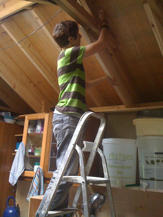 anna working on the ceiling