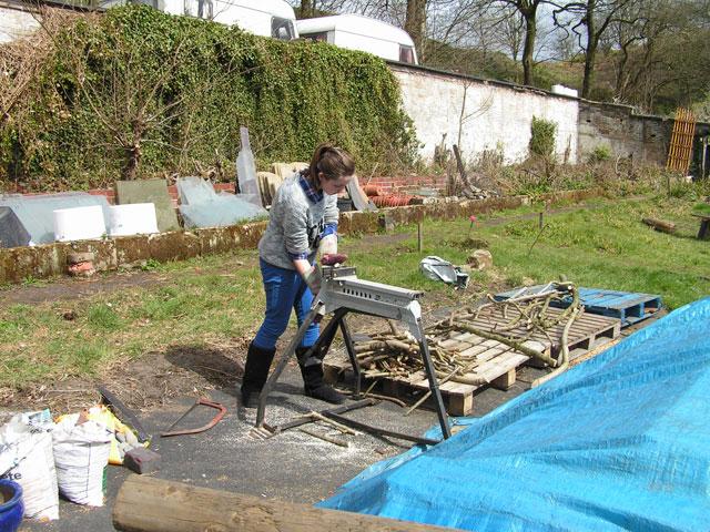 Annie cutting firewood