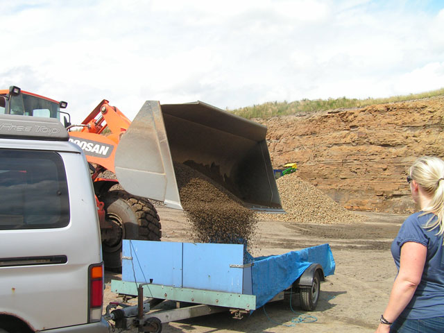 The gravel being tipped into the trailer