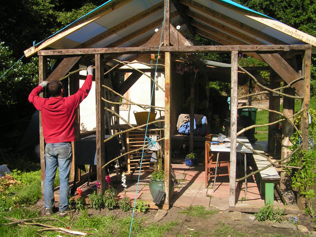 Francesco adding walls to the pergola