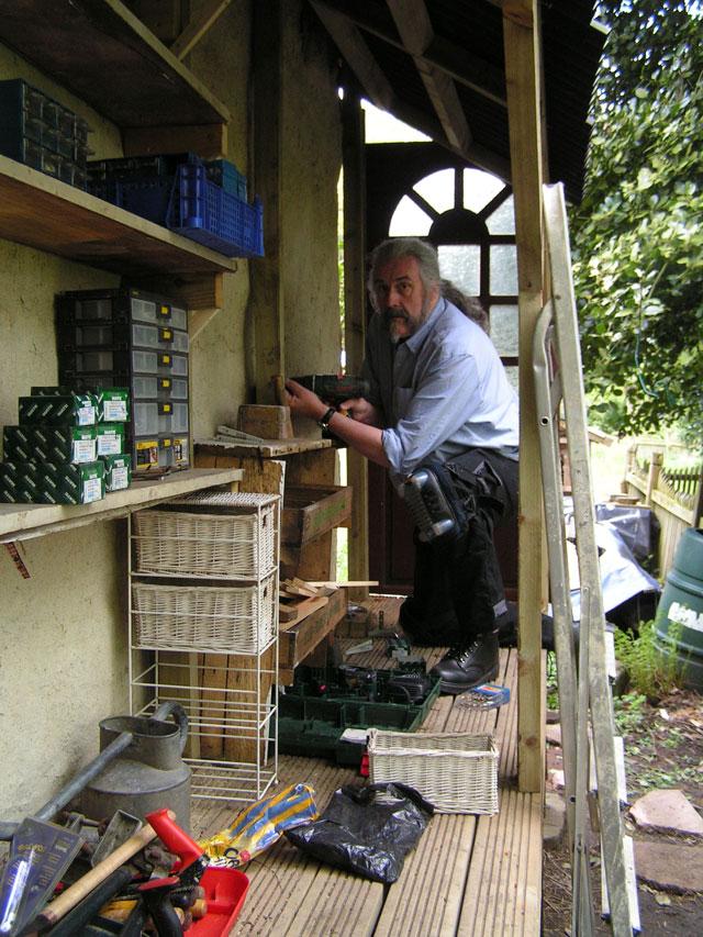 Alec building shelves