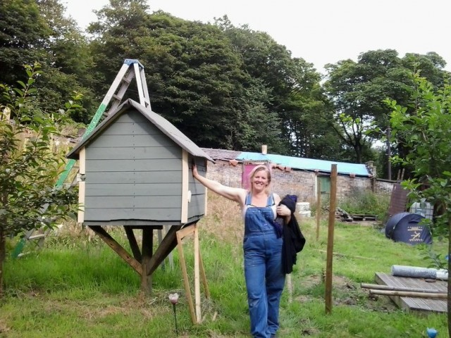leaning against the chicken house