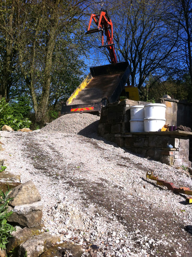 pile of gravel being delivered