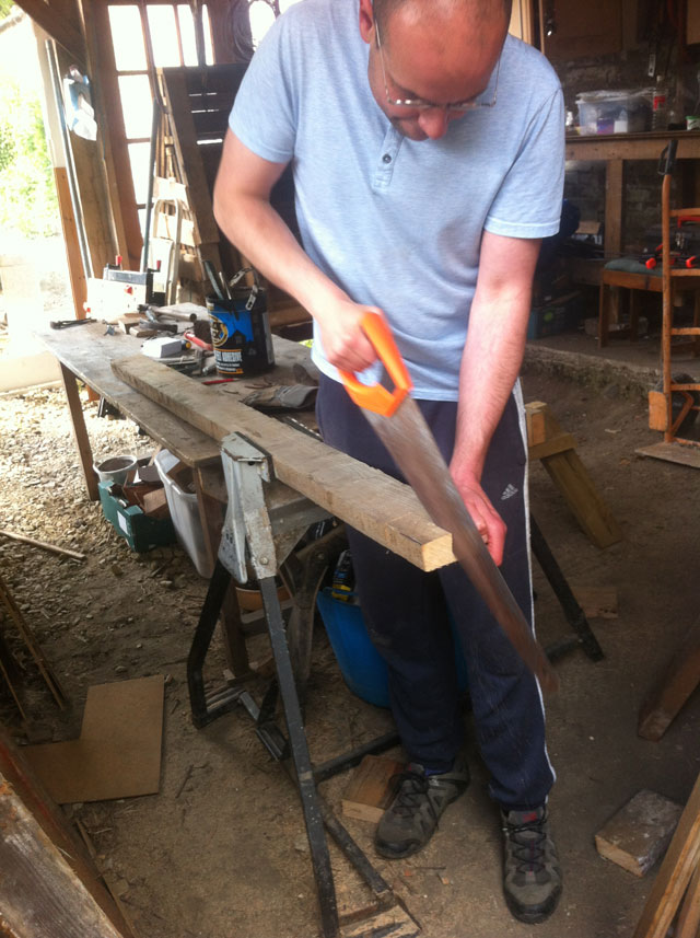 Jorge sawing wood