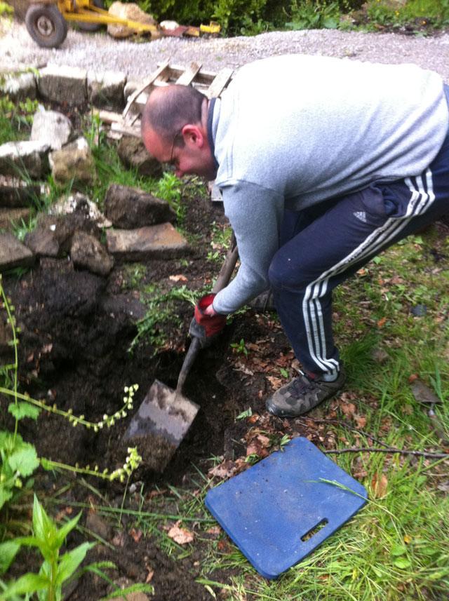 Jorge digging a hole